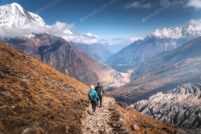 Walking people on the mountain trail at sunny day. Landscape
