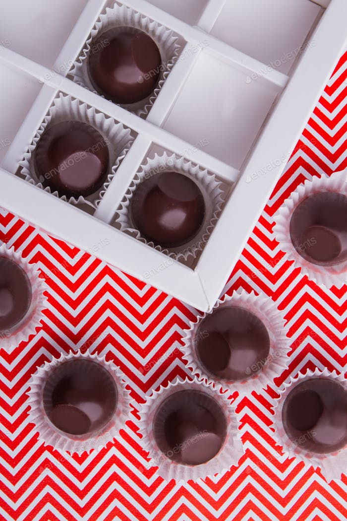 Top view sweet delicious round chocolate candies.