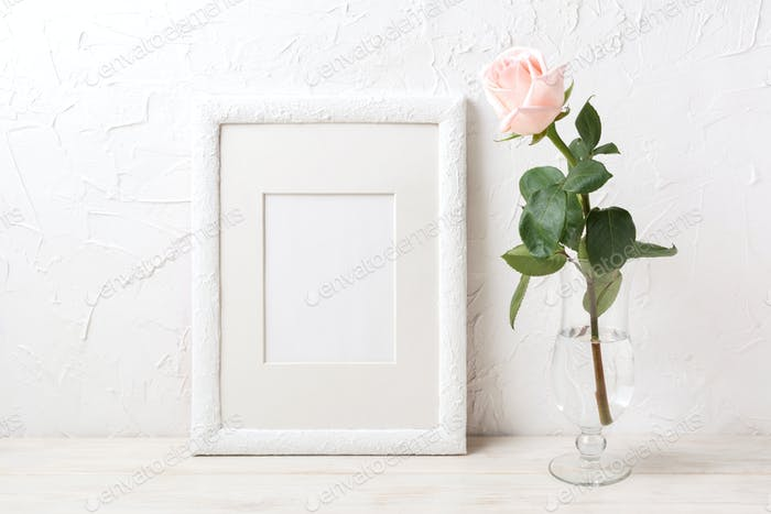 White frame mockup with rose in exquisite glass vase