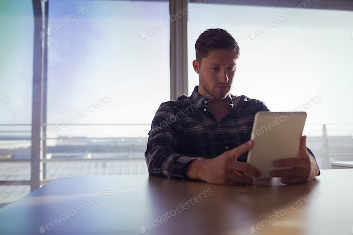 Businessman using digital table at office