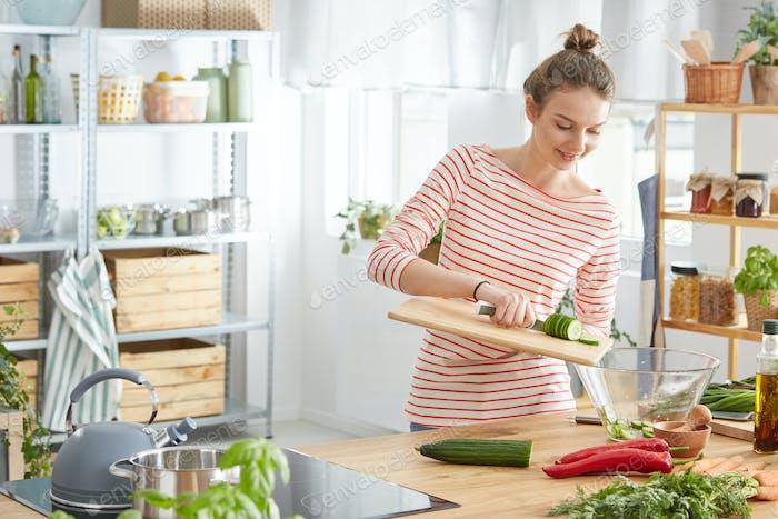 Cook preparing a salad