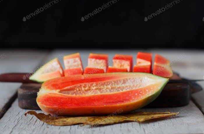 papaya sliced on wooden