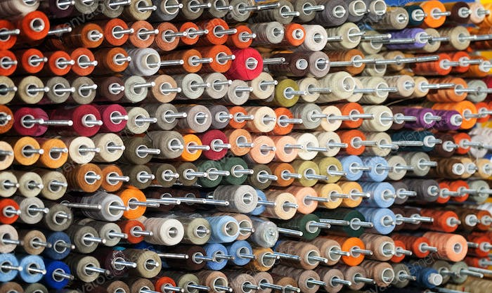 Background of the reels with colorful threads
