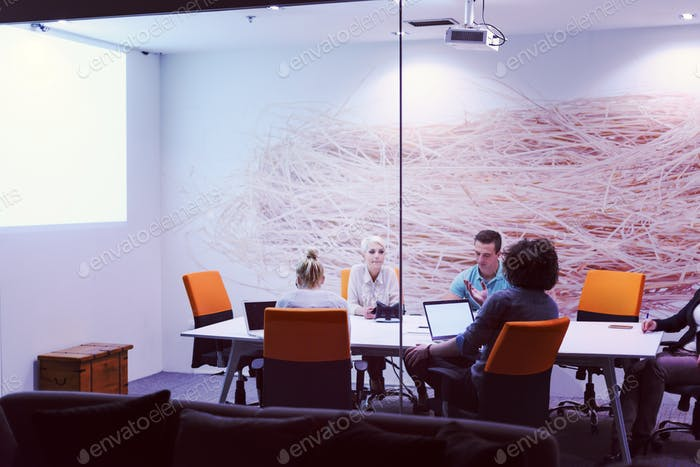 Startup Business Team At A Meeting at modern night office buildi