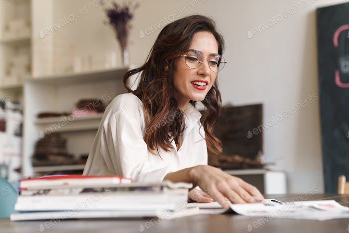Beautiful young brunette woman studying