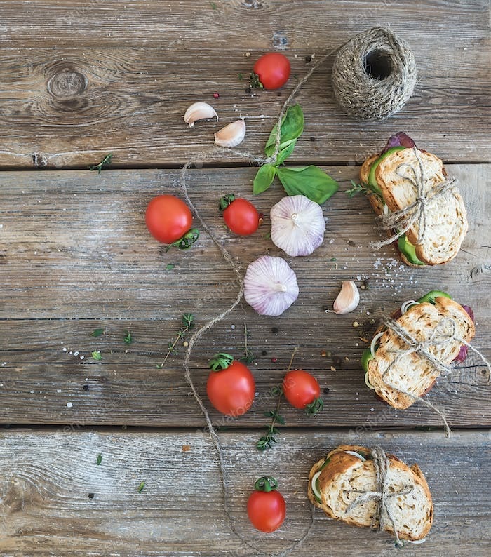 Rustic breakfast set. Sandwiches with smoked meat, cherry-tomato