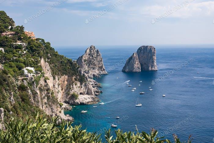 View of cliff coast of Capri Island with famous faraglioni rocks