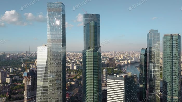 Glass skyscrapers, against the city background