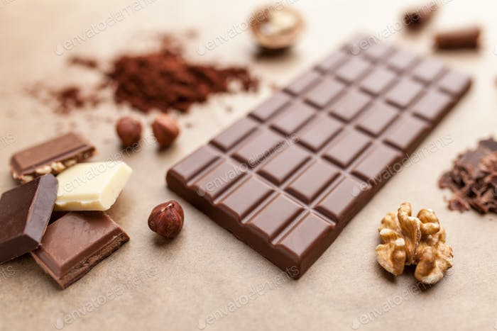 Delicious chocolate bar and ingredients