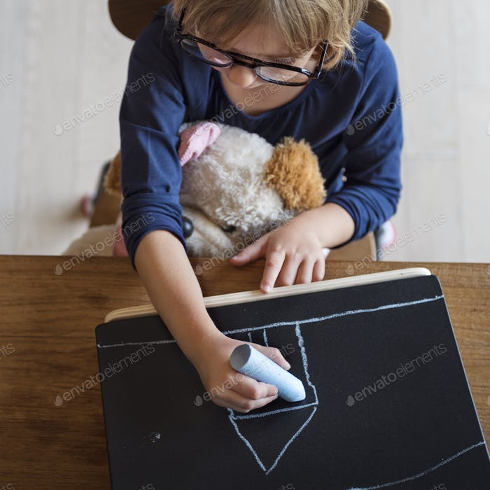 Little Girl Drawing Blackboard Concept