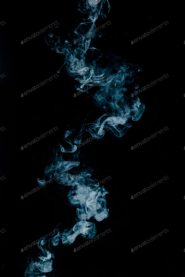 Vapor texture from a hot drink on a black background. Blue smoke with copy space.