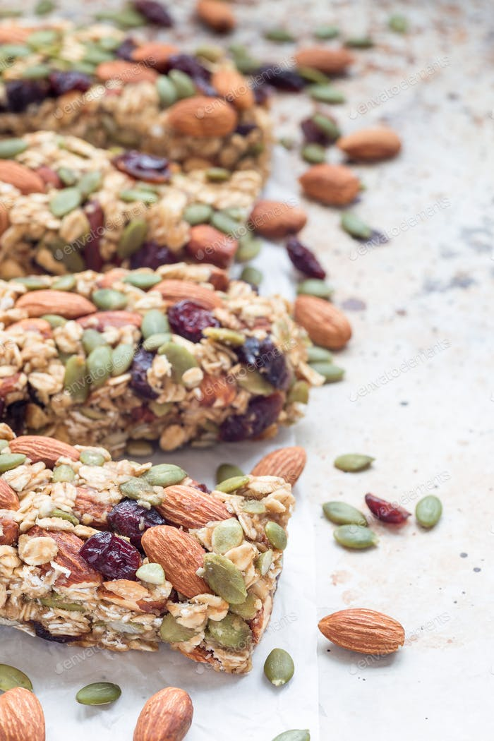Granola energy bars with figs, oatmeal, almond, dry cranberry and pumpkin seeds, copy space