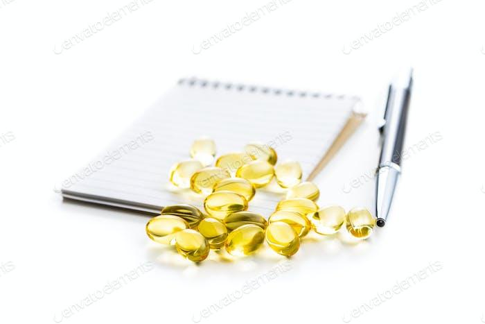 Omega 3 pills. Fish oil supplement capsules