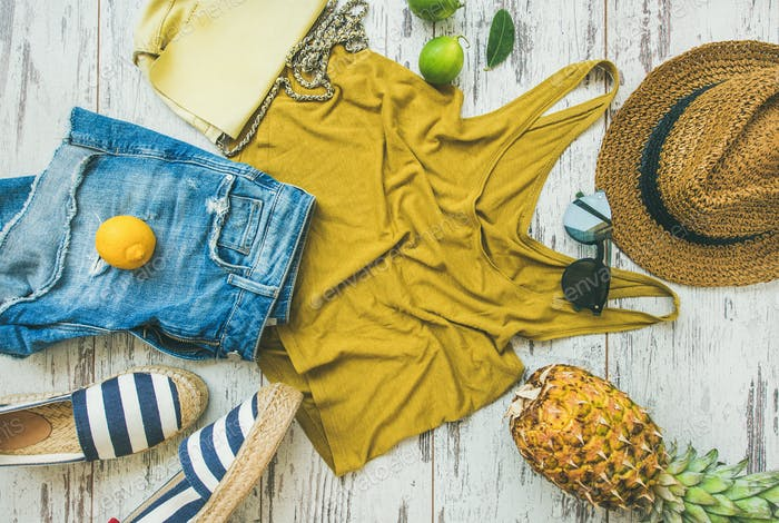 Colorful summer fashion outfit flat-lay over pastel background, top view