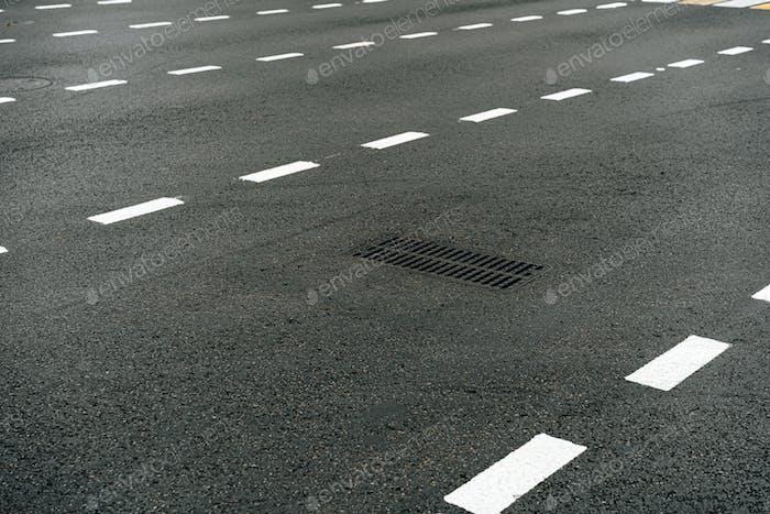 Asphalt street road with markings evening background