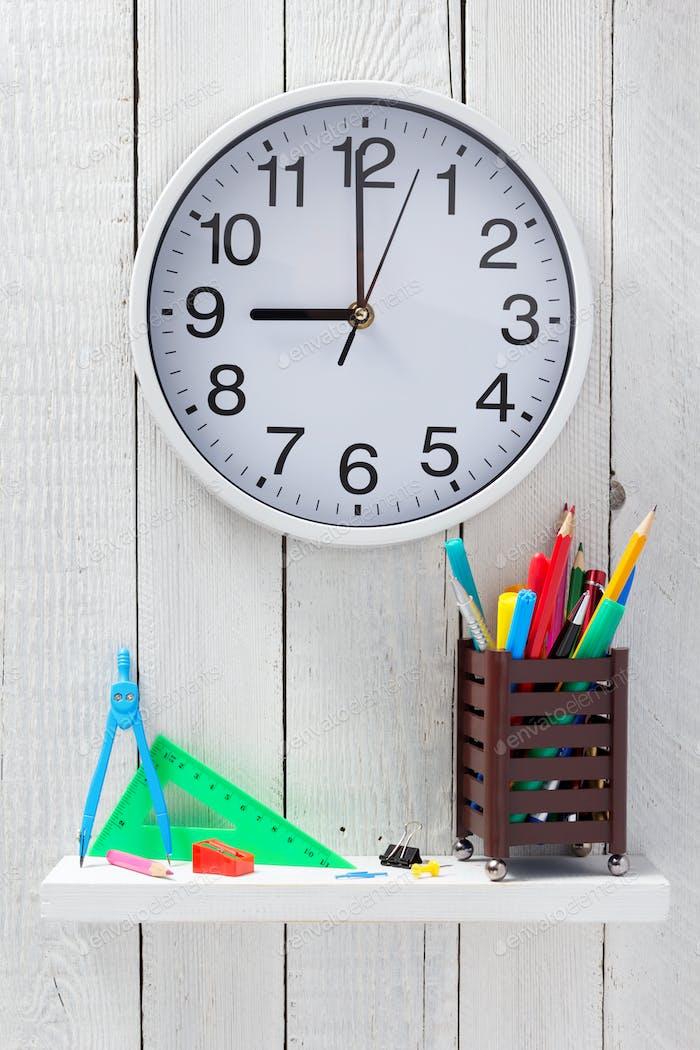 school supplies on wooden shelf