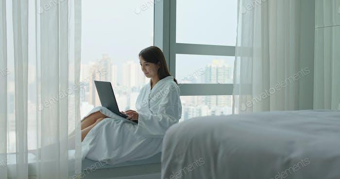 Woman work on laptop at quarantine period