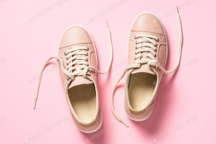 Pink shoes on pink top view