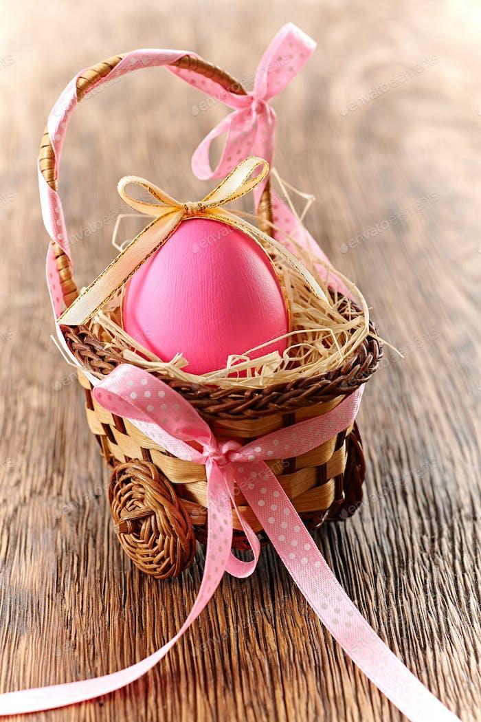 Easter painted egg in basket, handmade on wood