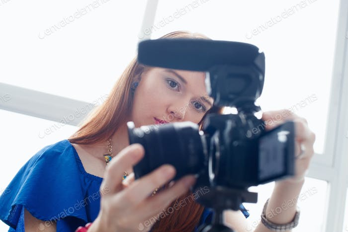 Woman Recording Vlog Video Blog Using DSLR Camera
