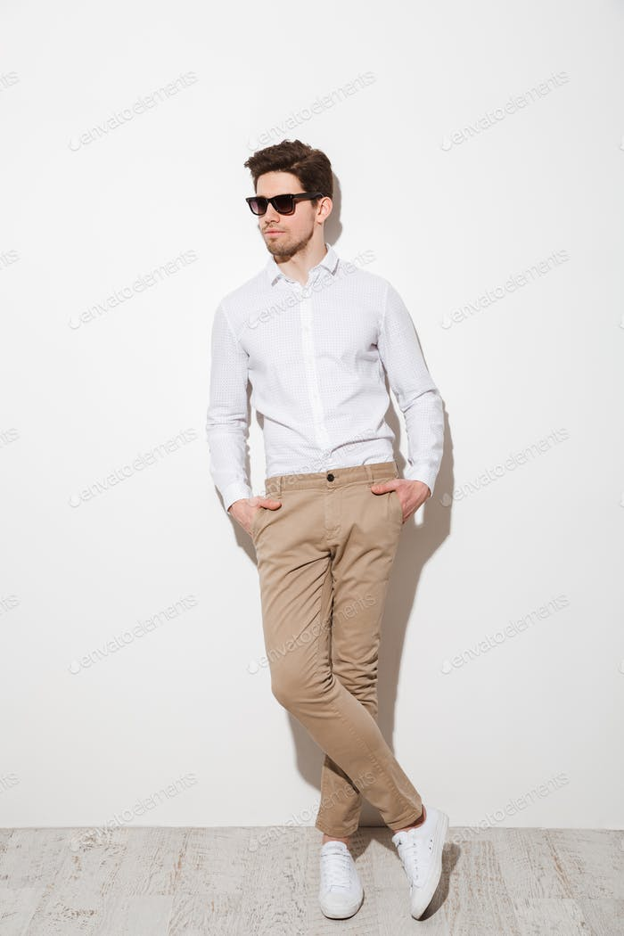 Full length picture of modern calm guy dressed in casual clothin
