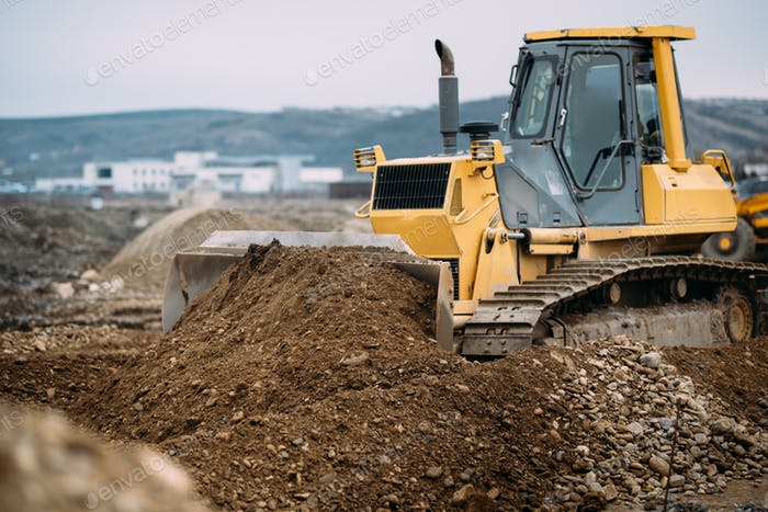 Industrial heavy duty machinery, details of excavator pushing earth and building highway.