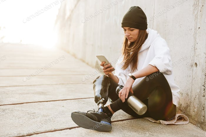 Photo of pretty young handicapped woman in streetwear having bio