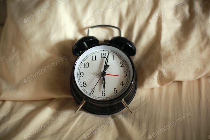Alarm Clock showing 6 o'clock