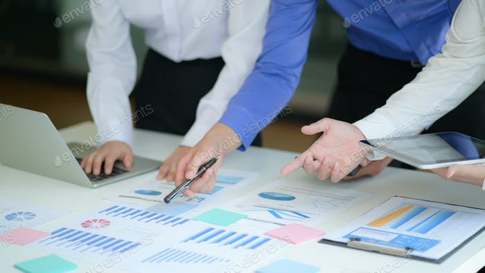 Office team is analyzing the results of the company from the data graph for management proposals.