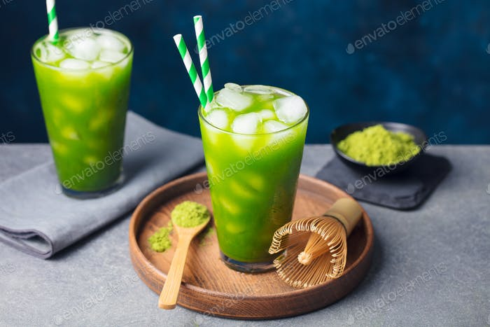 Thumbnail for Matcha, Green Ice Tea in Tall Glass on Wooden Plate. Grey stone Background. Copy space.
