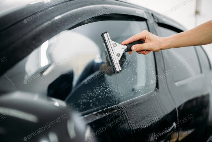 Specialist work, car window tinting installation