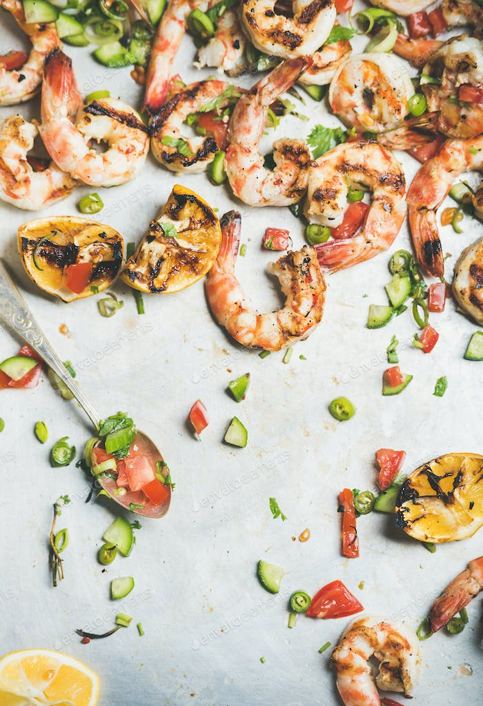 Grilled tiger prawns with lemon and mint salsa, top view
