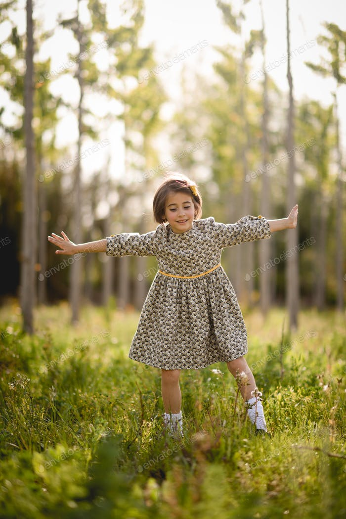 Thumbnail for Little girl in nature field wearing beautiful dress