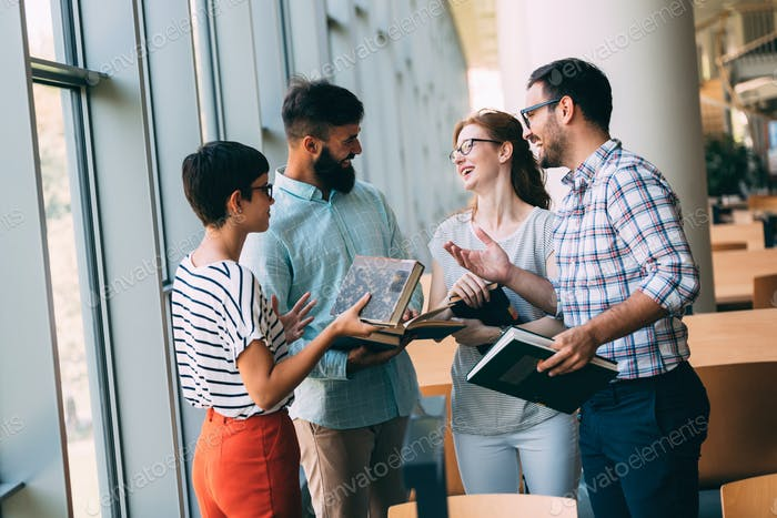 Group of students discussing in university library