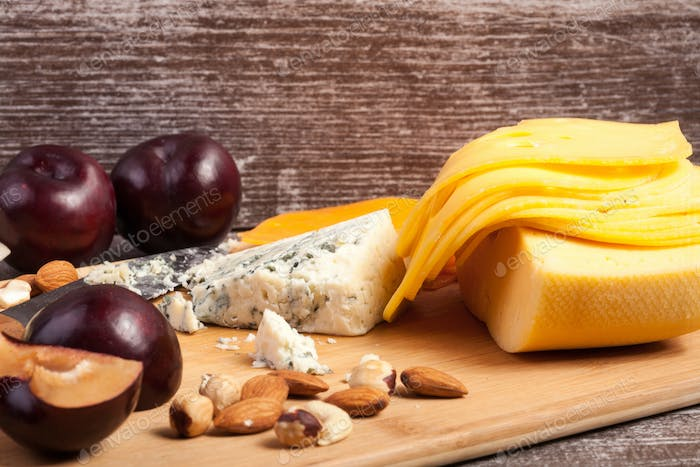 Gourmet cheese apetizer on wooden background