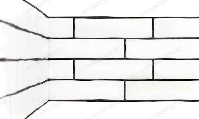 Weiße Backsteinmauer. Hintergrund mit weißen Keramikfliesen.