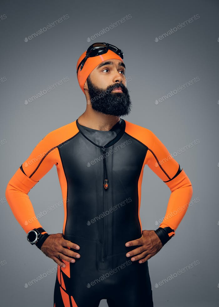 Male in scuba diving mask and orange neopren diving suit.