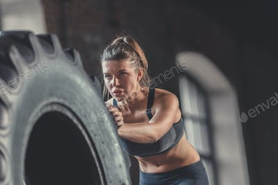 Sports young woman with a wheel close-up
