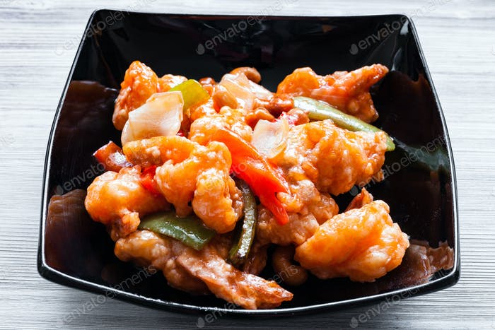 portion of stir-fried Shrimps with cashew nuts