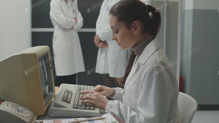 Woman working with an old computer
