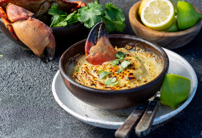 Baked crabmeat crab meat with cheese, cream and bread. Chilean Pastel o chupe de jaiba