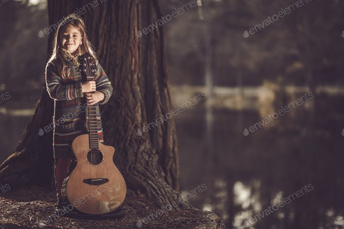 Girl With Guitar in the Park