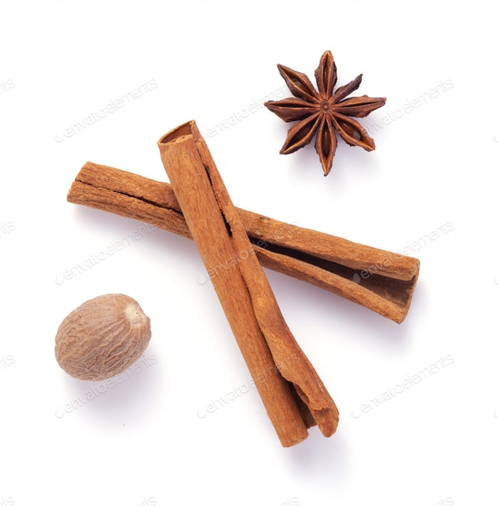 cinnamon stick, anise star and nutmeg on white background