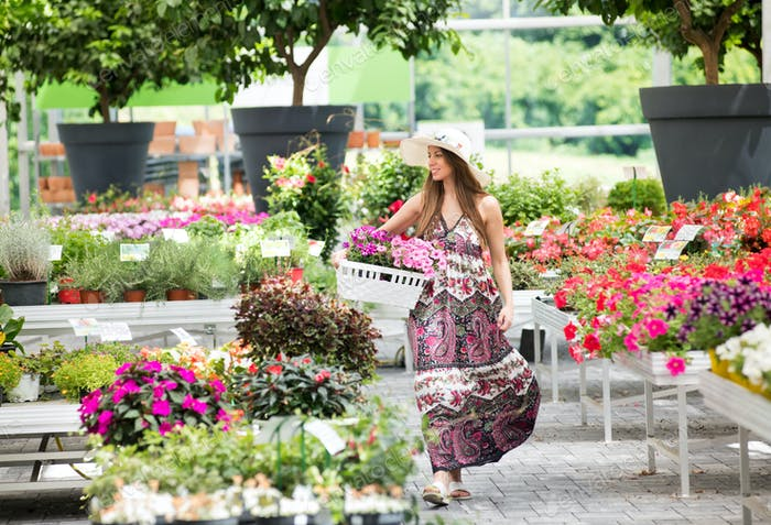 Fashionable young woman walking through a nursery