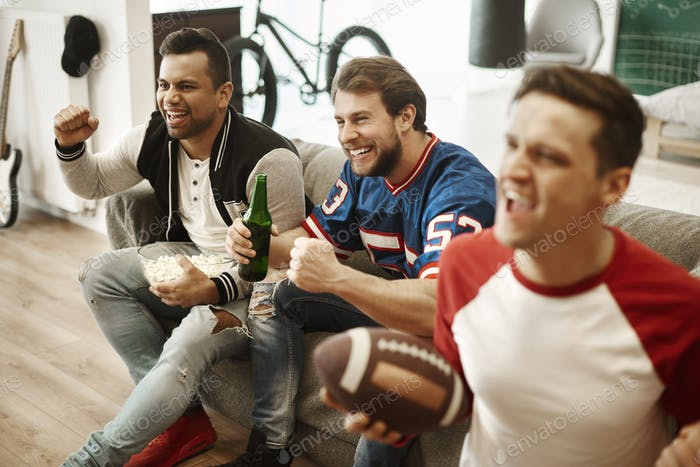Excited football fans watching american football