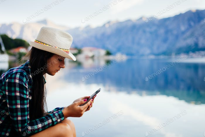 woman browsing smartphone at seaside