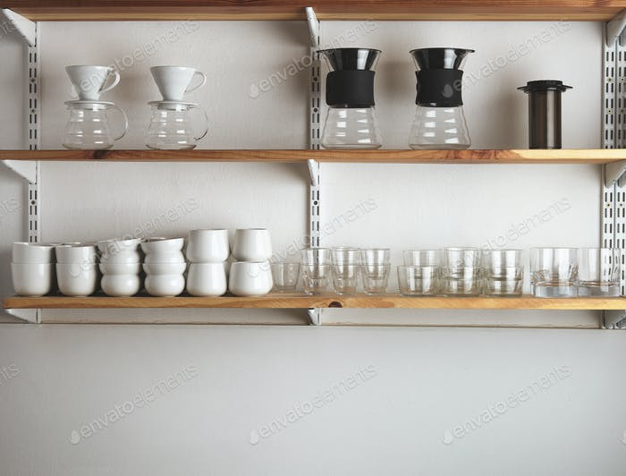Shelves with glasses and coffee makers