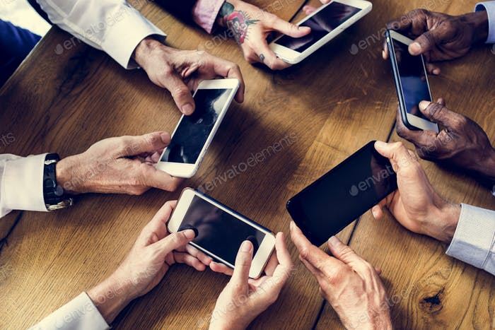 People hands using smartphone in a meeting