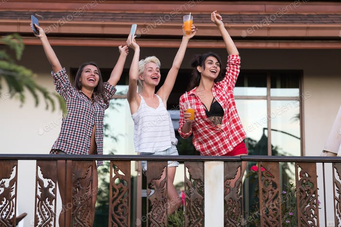 Young Cheerful Girls Group On Balcony Raised Hands, Beautiful Happy Smiling Woman Friends