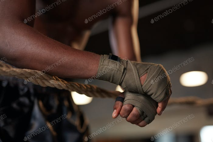 Boxer training on boxing ring